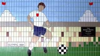 Tile mural showing footballers outside wembley