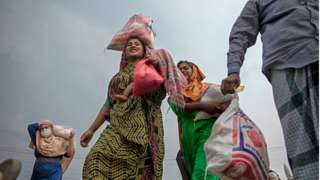 Women carry bags of food in Bangladesh