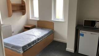 Empty bedroom with single bed