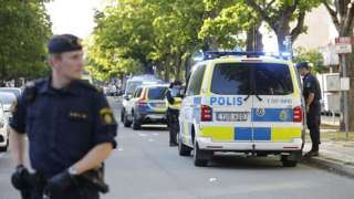 Police at the scene of a shooting in Stockholm