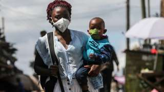 A Kenyan woman together with her son wear face masks during Easter Sunda