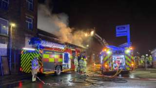 Fire crews at night at the scene