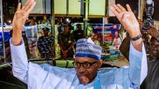 Muhammadu Buhari celebrating his victory