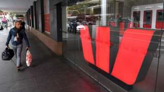A man walks past a Westpac bank branch in Melbourne