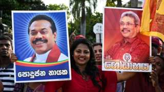 Supporters of Sri Lanka's President-elect Gotabaya Rajapaksa (right) wait near the election commission office in Colombo on November 17, 2019.