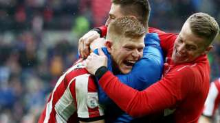 Lincoln City player's celebrate victory