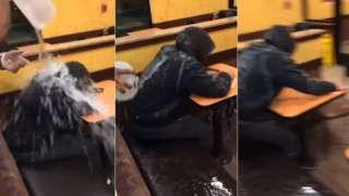Screengrabs from the video showing a man doused with water in a Dunkin' Donuts restaurant