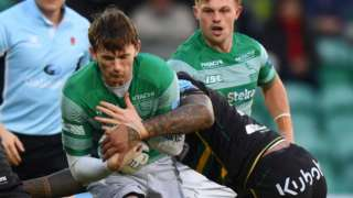 Simon Hammersley of Newcastle is tackled by Courtney Lawes of Northampton