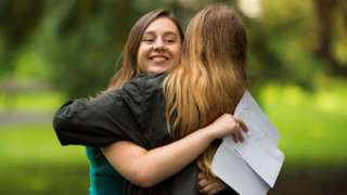 Caitlin Hannah hugs a fellow pupil after receiving 2 As and a A* in her A Level results at Ffynone House School in Swansea