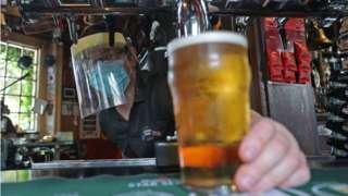 Bar worker pulls a pint