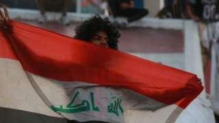 متظاهر في العراق