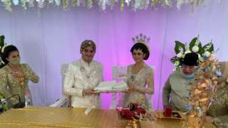 A bride and a groom in festive costumes