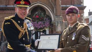 Cpl Joe Lovell (r) was presented his award by Lt Col Simon Carvel (l) in Woodbridge, Suffolk.