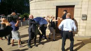 Claire Riley and family clash with media as they arrive for sentencing at Northampton Crown Court