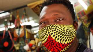 Man wearing face mask inside shop in Cape town