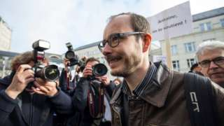 A former employee of PricewaterhouseCoopers Antoine Deltour arrives for the first day of his LuxLeaks whistleblower trial along with two other defendants in Luxembourg on 26 April 2016