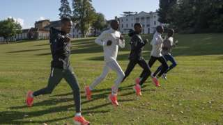 Althletes training together within the grounds of the biosecure bubble where the marathon will take place