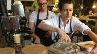 Two people working in bakery