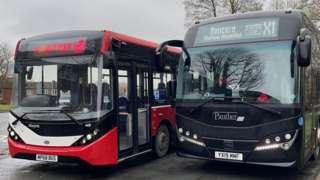 Two single decker buses