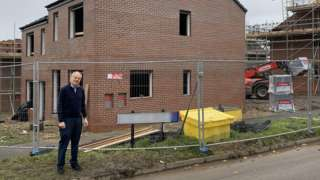 Clive Betts standing by a new build house