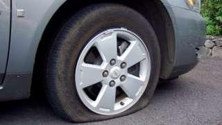 Car tyre slashed