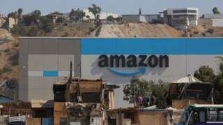 Shacks are seen at an informal settlement next the new Amazon fulfillment center, which is under construction at the RMSG Alamar Industrial Park, in Tijuana, Mexico September 7, 2021.