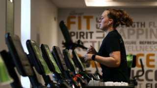 Woman exercising on a treadmill.