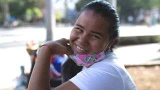 Venezuelan migrant Danexi Andrade poses for a photo in Medellin