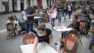 tables being cleaned at Di Maggio's outdoor restaurant area in Glasgow city centre.