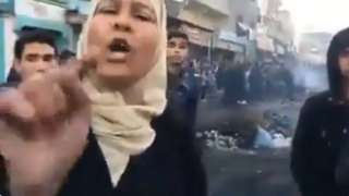 Screen grab from Twitter video showing angry Palestinian woman in Gaza Strip pointing at camera