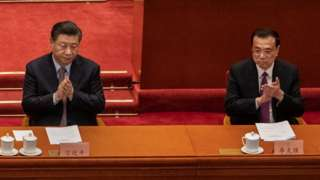 Chinese President Xi Jinping, left, and Premier Li Keqiang, right, applaud during the opening session of the Chinese People's Political Consultative Conference at the Great Hall of the People