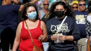 Women wearing face coverings in LA