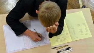 Boy doing an exam.