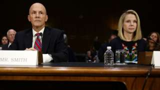 Former CEO of Equifax Richard Smith (L) and former CEO of Yahoo Marissa Mayer (R) wait for the beginning of a hearing before Senate Commerce, Science and Transportation Committee November 8, 2017 on Capitol Hill in Washington, DC