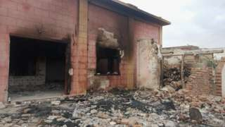 The ransackers smashed temple walls with sledgehammers and set it on fire