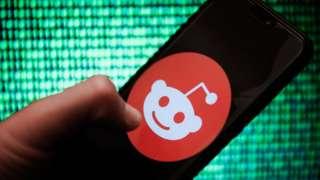 A Reddit logo on a smartphone