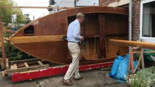 Mr Goodchild with boat in patio