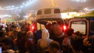 Ambulances in the Iraqi capital Baghdad attend to injured protesters