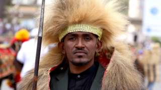 Ethiopian musician Haacaaluu Hundeessaa poses while dressed in a traditional costume during the 123rd anniversary celebration of the battle of Adwa, where Ethiopian forces defeated invading Italian forces