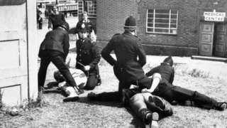Police officers restrain striking miners at Orgreave Coking Plant, at Rotherham, in May 1984