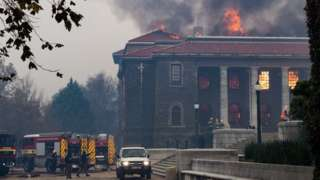 Firefighters try to extinguish a fire in the Jagger Library, at the University of Cape Town
