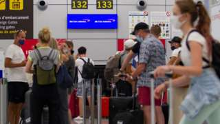 Passengers check-in for flights back to the UK at an airport in Mallorca