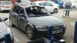 Shell of exploded car in Wrexham