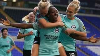 Danielle Carter celebrates her goal for Brighton