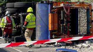 upturned bin lorry