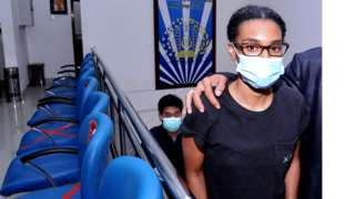 An American woman and self-described digital nomad Kristen Gray looks on after being examined at the Indonesian Immigration office in Denpasar, Bali, Indonesia