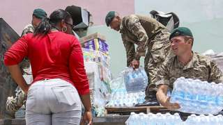 Soldiers giving out supplies in BVI