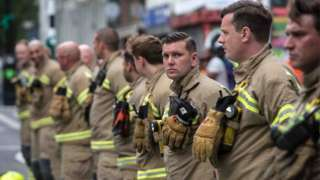 Firefighters paying respects at the fourth anniversary memorial for the Grenfell fire