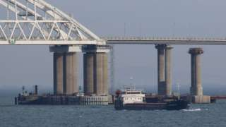A vessel sails past a bridge connecting the Russian mainland with the Crimean Peninsula across the Kerch Strait, Crimea November 26, 2018