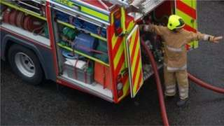 Firefighter and fire appliance